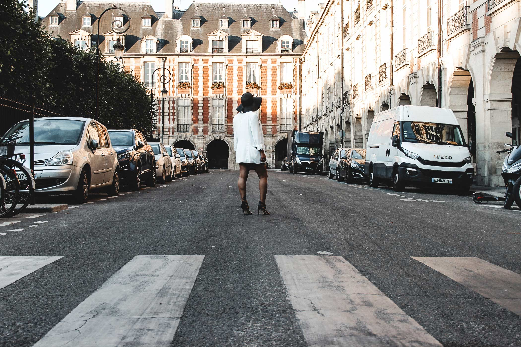 "Travel girl walking in the street, ""place des vosges"" in paris. famous place in Paris."