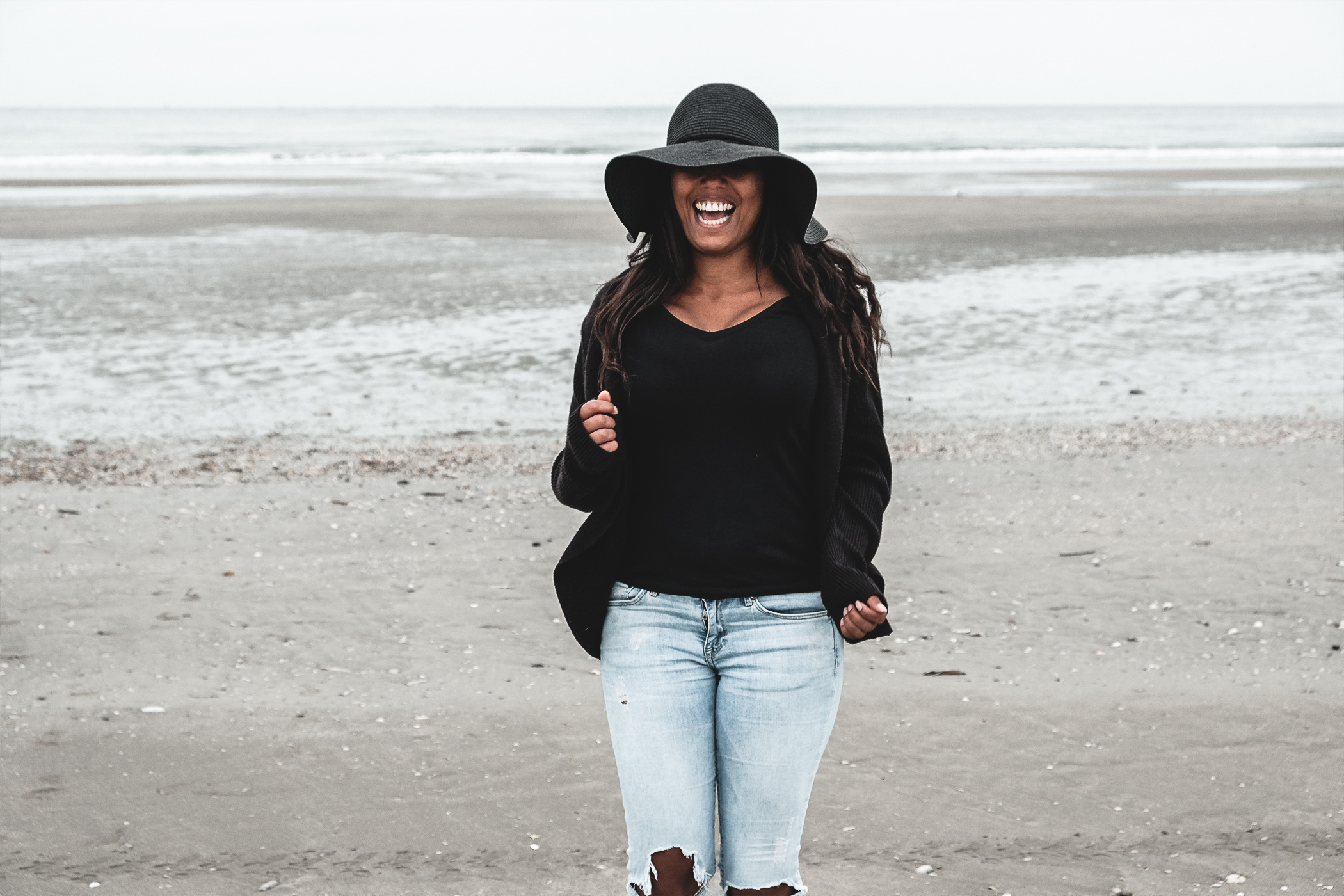 Travel girl at Deauville, Normandy France, laughing to the beach