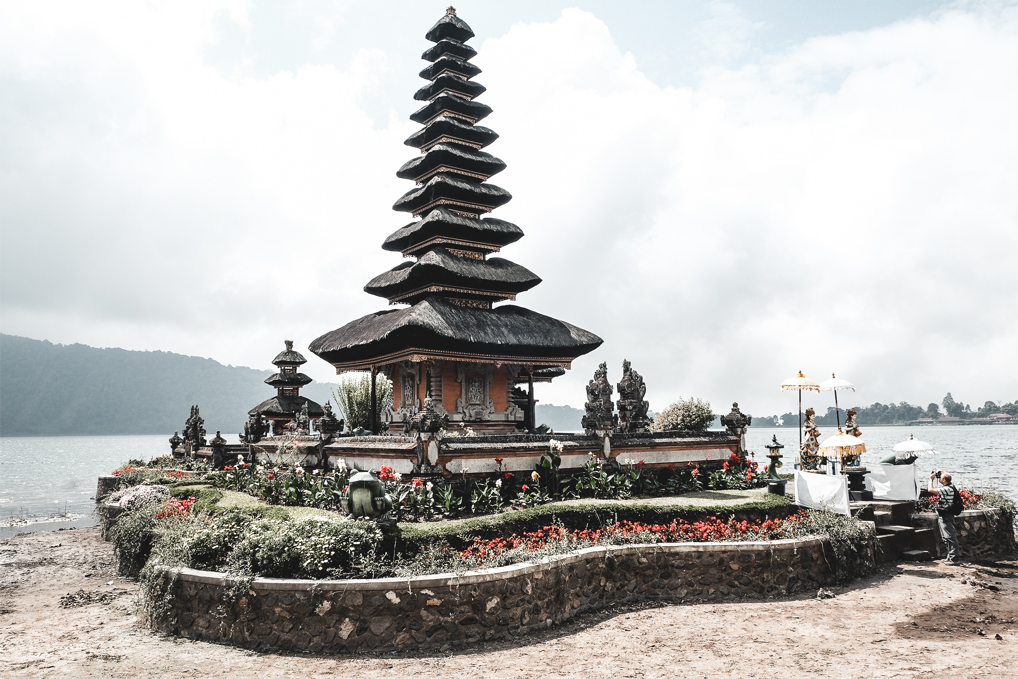 Travel blogger vibes, girl visiting Bali. Pura Ulun Danu Bratan or Pura Bratan . Ubud Indonesia. Bali travel.