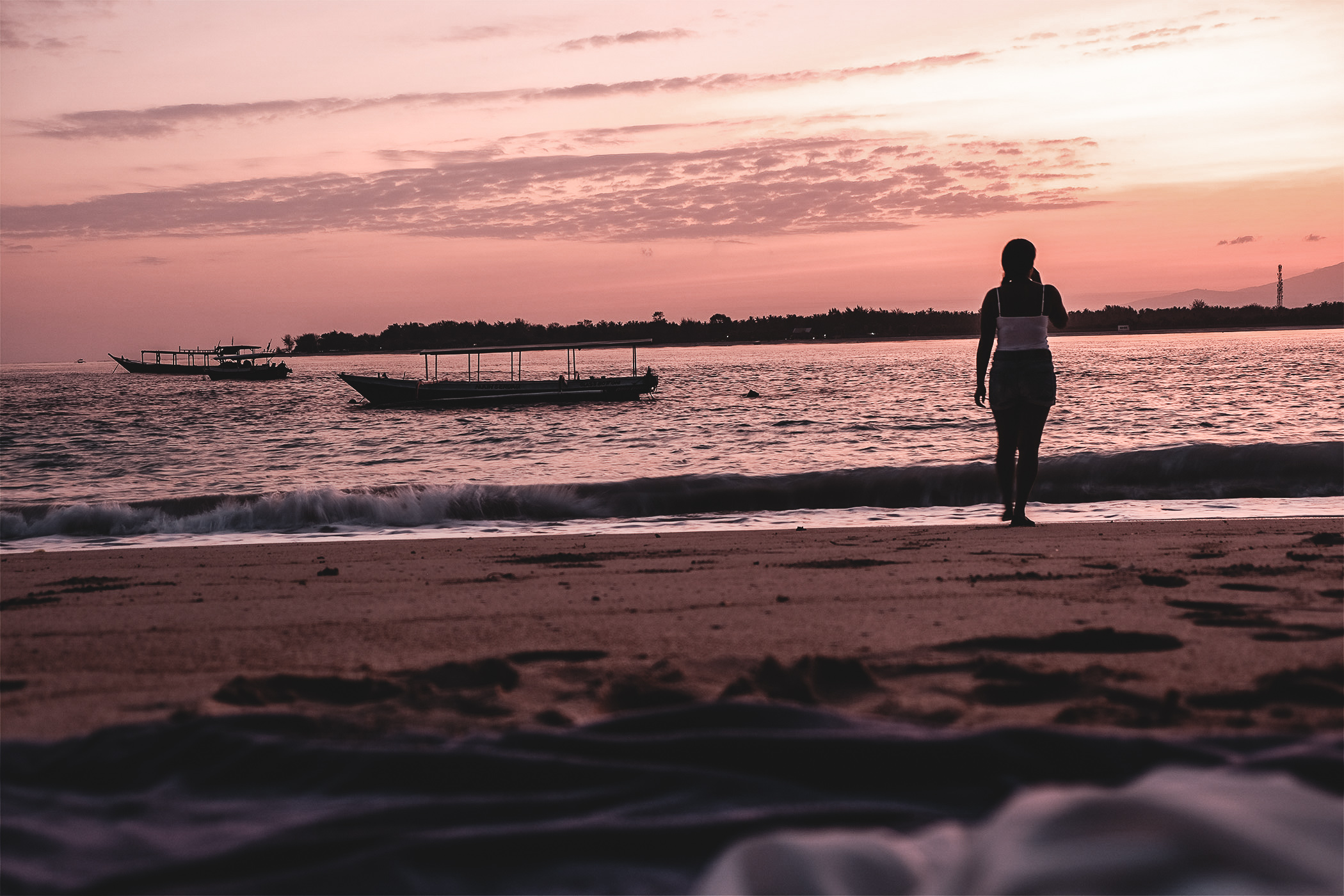 Sunset, beach, pink sky, travel girl, visiting Gili Trawangan, Island Gili from Bali. Best place to stay and enjoy chill and nature. Turtle