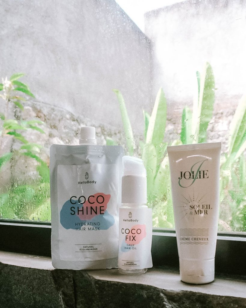 Natural product for a hairstyle. Travel girl in Paris, Hello body product for hair, coconut hairstyle