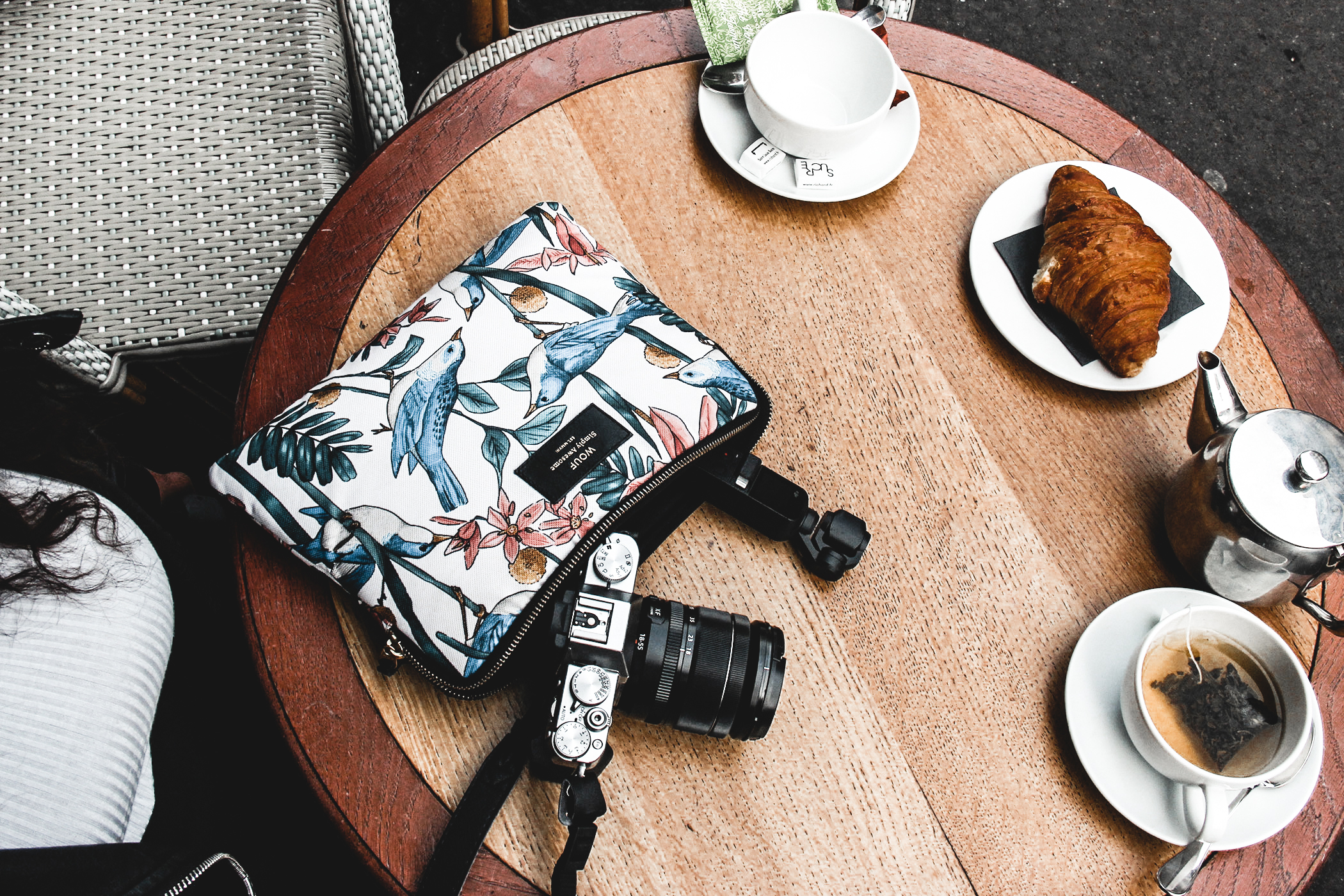 Travel girl in Paris, using Fujifilm TX 30 & DJI Osmo pocket camera to make video and wonderful photography. Setting at a Parisian Cafe. Pochette WOUF.