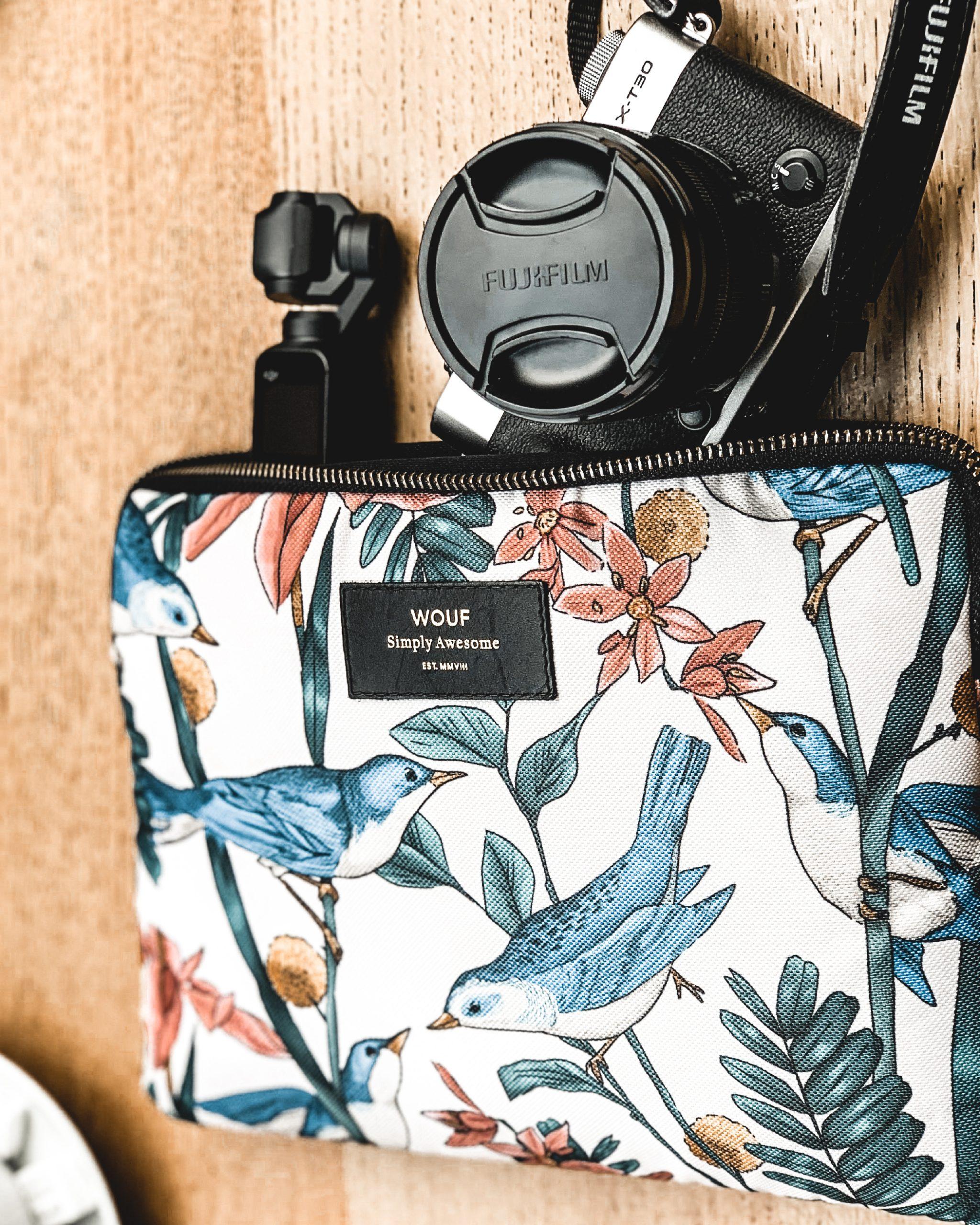 Travel girl in Paris, using Fujifilm TX 30 & DJI Osmo pocket camera to make video and wonderful photography. Setting at a Parisian Cafe